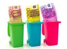 Colorful recycle bins with euro money inside Royalty Free Stock Image