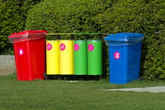 Colorful recycle bins in the park Royalty Free Stock Images