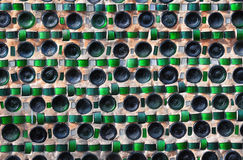 Colorful recycling background with texture of empty wine bottles. In the wall Stock Images