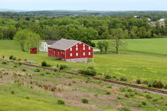 Colorful red barn and farmhouse in countryside Stock Photo