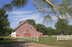 Colorful Red Barn and Fence Royalty Free Stock Image