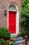 Colorful red door and brick wall Stock Photo