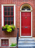 Colorful red door and brick wall Royalty Free Stock Image
