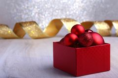 Colorful red gifts with Christmas balls on silver background stock images