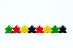 Colorful red, green, yellow and black wooden dolls Royalty Free Stock Image