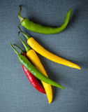 Colorful red, green and yellow chili peppers Stock Image