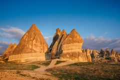 Colorful Red mountain valley in Cappadocia landscape at sunset royalty free stock photography