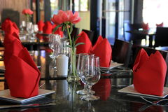 Colorful red napkins and neat table settings on table at restaurant Royalty Free Stock Photo
