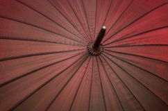 Abstract red color umbrella background, diagonal elements and centre. royalty free stock images