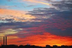 Colorful red orange dark dramatic evening sky over industrial la stock photo