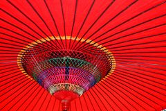 Colorful Red Parasol. Looking up at a colorful red parasol in Japan Royalty Free Stock Images