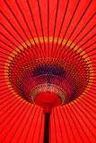 Colorful Red Parasol Underneath. Looking up at a colorful red parasol in Japan stock images