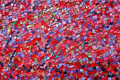 Colorful red, pink, yellow, and purple stone mosaic tiles on the wall. As background or texture stock image
