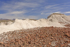 Colorful Red Rock on White Ash in the Desert Royalty Free Stock Images