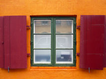 Colorful red shutters on a window. Colorful red shutters on a European building Stock Images