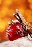 Colorful red snowflake Xmas bauble with skis Stock Photo