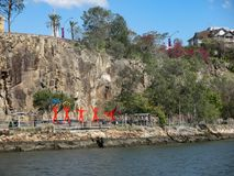 Colorful red sports figures by the water under Kangaroo Point Cliffs on the south side of the River Brisbane QLD Australia Septemb. The Colorful red sports stock photo
