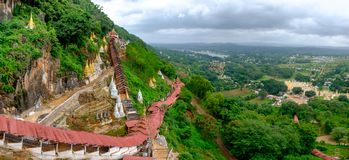 Colorful red staircase roofs and beautiful landscape at Pindaya caves, Myanmar stock photo