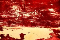 Colorful red texture of old paint on rusty metal door.  stock images