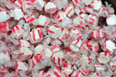 Colorful red and white peppermint salt water taffy. Lots of colorful red and white peppermint salt water taffy candies Royalty Free Stock Photo