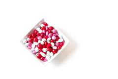 Colorful red, white, pink coated Valentine candy in a bowl isolated on white background. With room for copy space royalty free stock photo
