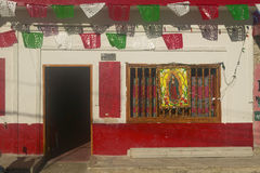 Colorful red and white storefront in Celestun, Mexico in Yucatan Peninsula, Mexico Stock Photo