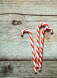 Colorful red and white striped Xmas candy canes Royalty Free Stock Photos