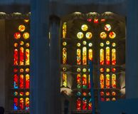 Colorful red, yellow and orange stained glass window of the Sagrada Familia. Large unfinished Roman Catholic church in Barcelona, designed by Catalan stock photo