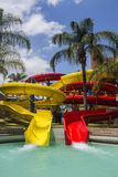 Colorful red and yellow water slide in aqua park. Stock Photography