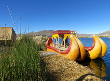 Colorful Reed Boat. Reed boat next to a floating island on Lake Titicaca Royalty Free Stock Images