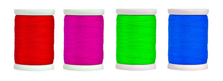 Colorful reels with thread isolated on white Royalty Free Stock Photo