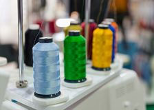 Colorful reels of threads on professional machine for applying embroidery. On different tissues closeup Stock Photography