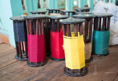 Colorful reels. On wooden floor royalty free stock photo