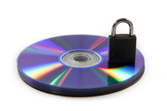 Colorful Reflected DVD and Data Security. Colorful Reflected CD / DVD object with a key for data security / privacy on white background Stock Image