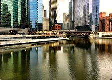 Colorful reflection of cityscape on a freezing Chicago River during winter rush hour commute. Colorful reflection of cityscape painted on a nearly-frozen Stock Images