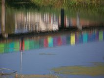 Colorful reflection in water stock image