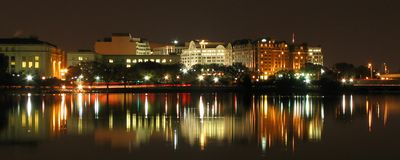 Washington D.C night scene. Night scene of Washington D.C, with lights reflecting on Potomac river in foreground, U.S.A Royalty Free Stock Images