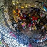 Colorful reflections in a disco ball, closeup. Party, disco concept. stock photos