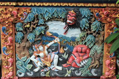 Colorful relief mural of Ramayana Hindu myth in Bali. Colorful relief mural of characters from Ramayana myth on wall of Balinese Temple stock photo