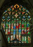 Colorful religious stained glass window, St. Vitus Cathedral in Stock Photo