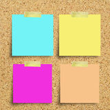Colorful reminder notes on a corkboard Royalty Free Stock Image