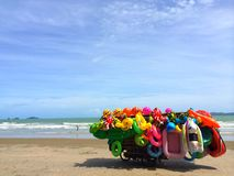 Colorful rental inflatable toys stall by the sea. Close up colorful rental inflatable toys stall on Rayong beach, Thailand on a beautiful sunny day with blur Stock Images