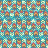 Colorful repeating pattern with zigzag lines, arrows and hexagons royalty free illustration
