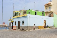 Colorful residential building Sal Rei. Colorful residential building and stone paved at Avenida dos Pescadores English: Fishermans street in Sal Rei Boa Vista stock image