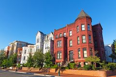 Residential townhouses in the highly sought after Capitol Hill neighborhood in Washington DC, USA. Colorful residential buildings surrounded by trees in US Royalty Free Stock Photography