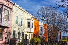 Colorful residential row houses under bright afternoon sun. Royalty Free Stock Image