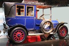 Colorful retro automobile. Luxurious blue retro automobile with red spokes Royalty Free Stock Photos