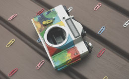 Colorful retro camera on the table Stock Images