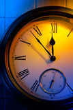Colorful retro clock. Mysterious clock shows 5 minutes to midnight stock image