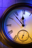 Colorful retro clock. Mysterious clock shows 5 minutes to midnight royalty free stock photos